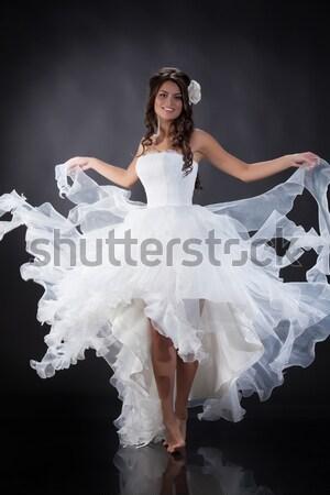 Fiatal menyasszony gyönyörű nő esküvői ruha stúdió mosoly Stock fotó © user_9834712