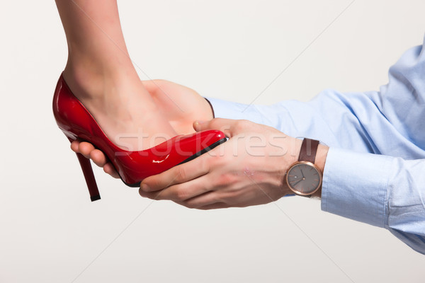 Lábak cipő kéz segít nők háttér Stock fotó © user_9834712