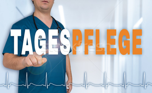 Tagespflege (in german Day care) doctor showing on viewer with h Stock photo © user_9870494