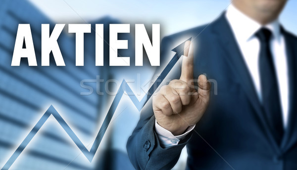 Aktien (in german shares) touchscreen is operated by businessman Stock photo © user_9870494