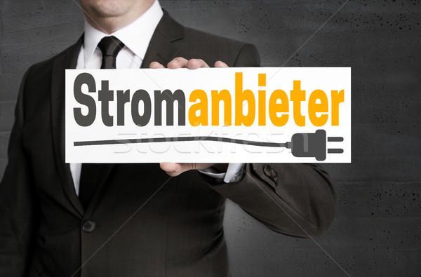 Stromanbieter (in german Electricity provider) sign is held by b Stock photo © user_9870494