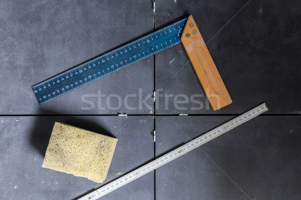Tiles concept tool, angle, ruler, sponge on tiles top view Stock photo © user_9870494