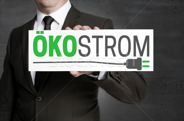 Oekostrom (in german Green electricity) sign is held by business Stock photo © user_9870494