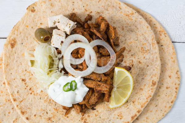 Gyros pita with tzatziki coleslaw olives and feta cheese Stock photo © user_9870494