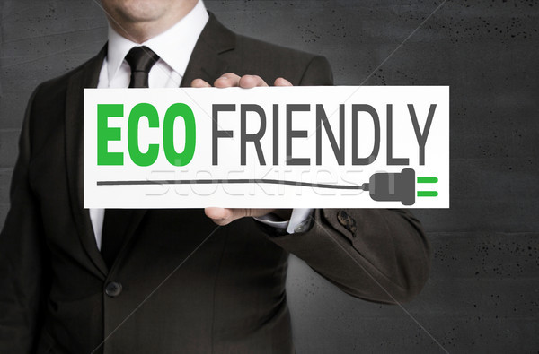 Eco friendly signboard is held by businessman Stock photo © user_9870494