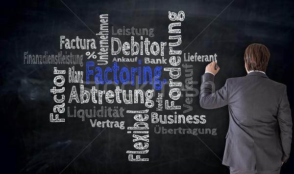 Businessman writes factoring cloud on blackboard concept Stock photo © user_9870494