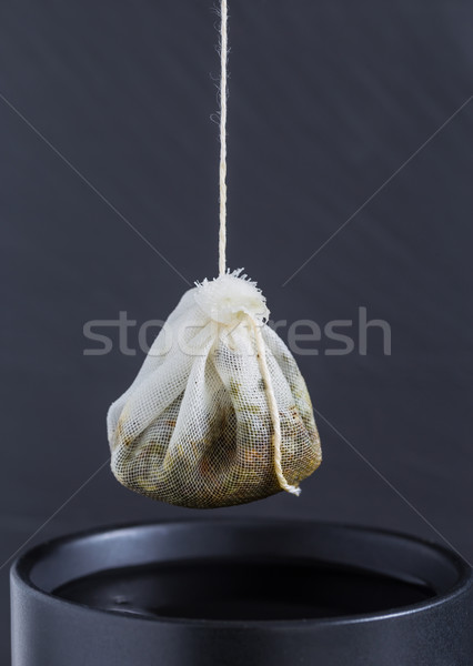 Tea bag is hung in a cup Stock photo © user_9870494
