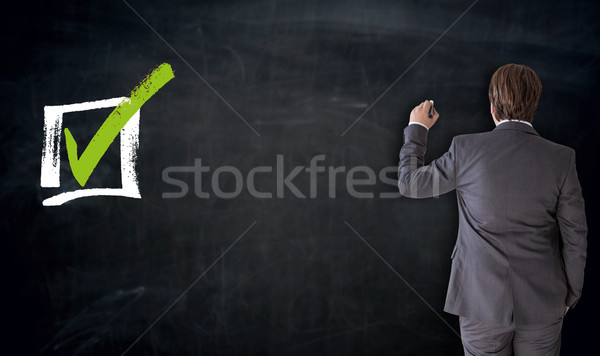 Businessman writing with checkbox concept on blackboard Stock photo © user_9870494