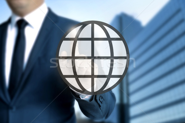 Globe touchscreen is operated by businessman Stock photo © user_9870494