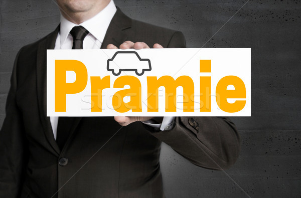 Praemie (in german bonus) with car sign is held by businessman Stock photo © user_9870494