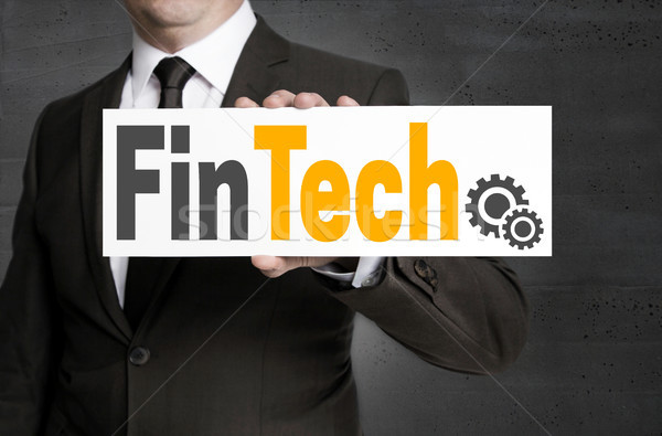 FinTech sign is held by businessman Stock photo © user_9870494