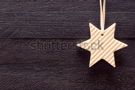 Christmas card with star on blue wood Stock photo © user_9870494