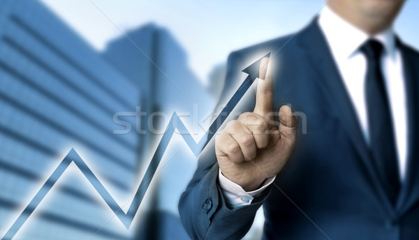 Graph touchscreen is operated by businessman Stock photo © user_9870494