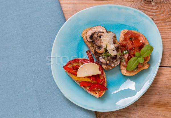 брускетта помидоров грибы Козы сыра древесины Сток-фото © user_9870494