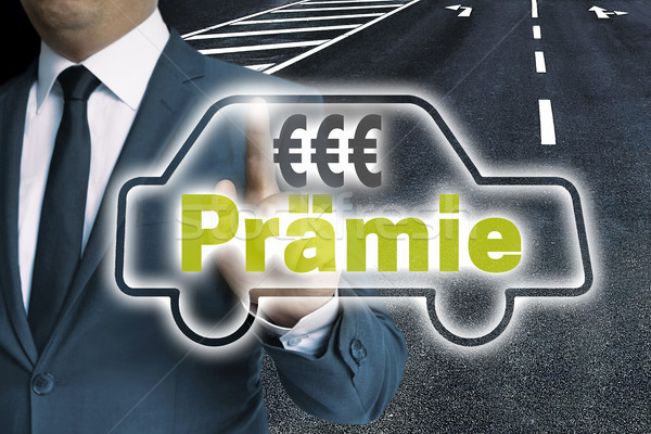 Praemie (in german bonus) car touchscreen is operated by man con Stock photo © user_9870494