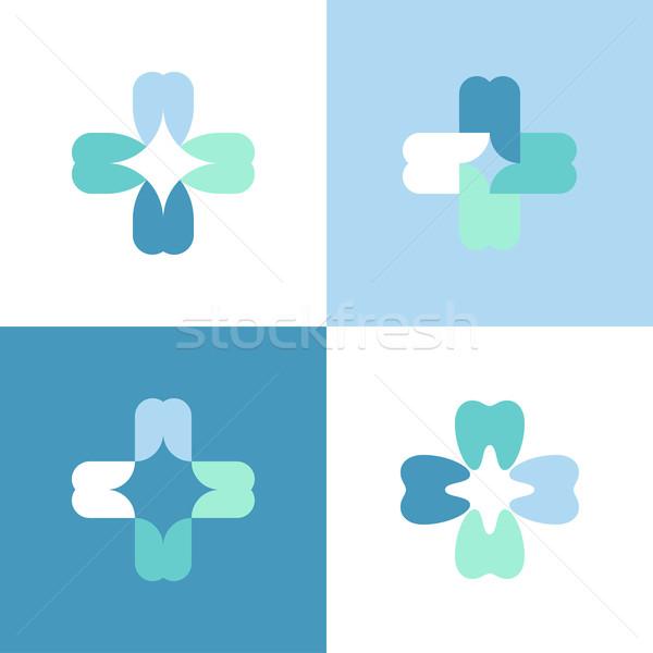 Stock photo: Teeth cross. Vector logo mark template or icon for dental clinic