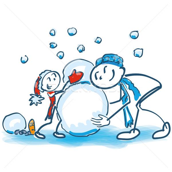 Vara filho pai construir boneco de neve família crianças Foto stock © Ustofre9