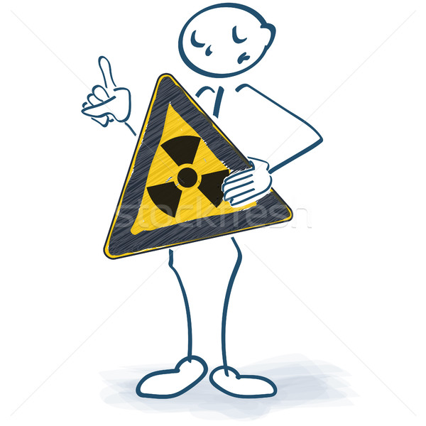 Stick figure with a sign that warns of atomic radiation in front of the body Stock photo © Ustofre9