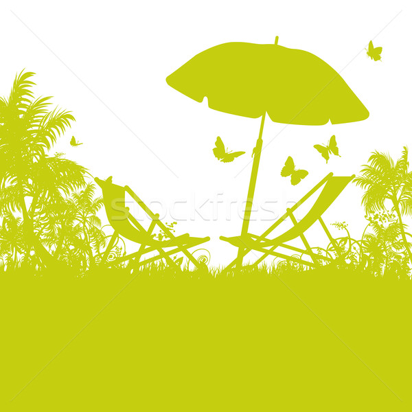 Beach umbrella and deck chairs on palm beach  Stock photo © Ustofre9