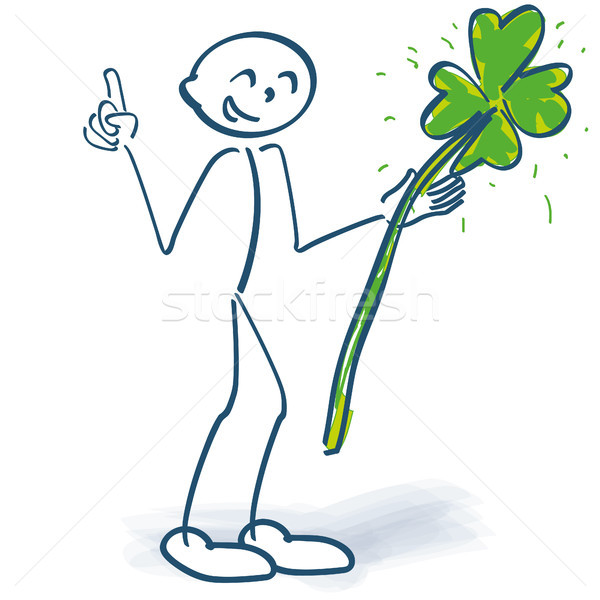 Stick figure with green shamrock and finger pointer Stock photo © Ustofre9