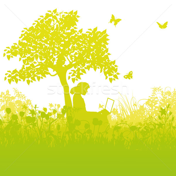 With a laptop in the grass under a tree in the garden Stock photo © Ustofre9