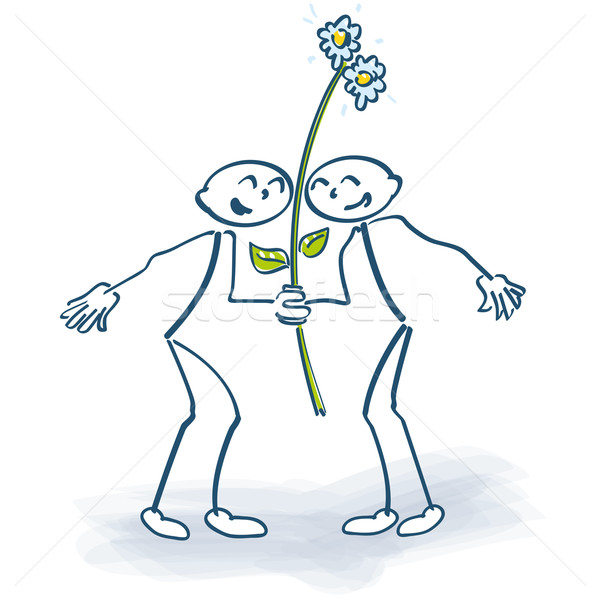 Two stick figures with a flower on a lolly Stock photo © Ustofre9