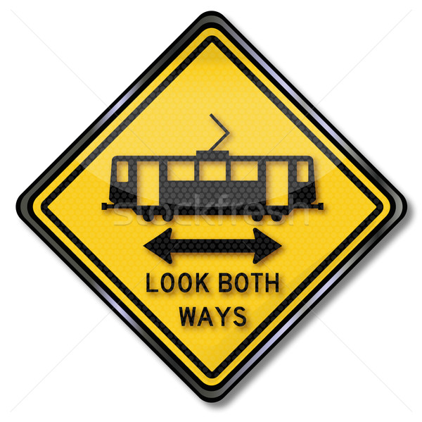 Road sign caution tram look both ways Stock photo © Ustofre9