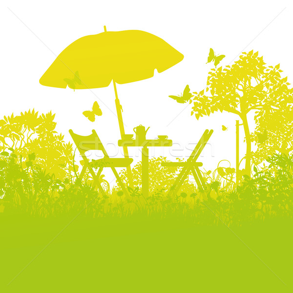 Two garden chairs with umbrella in the orchard Stock photo © Ustofre9