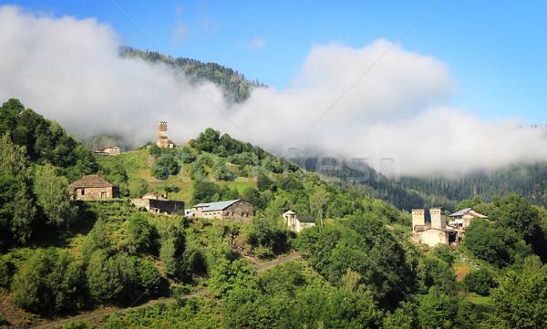 горные деревне древних towers утра тумана Сток-фото © vadimmmus