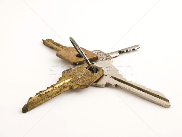 Kulcsok izolált öreg rozsdás fehér közelkép Stock fotó © vadimmmus