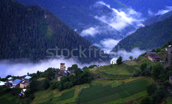 Ködös falu hegy ősi tornyok kék Stock fotó © vadimmmus
