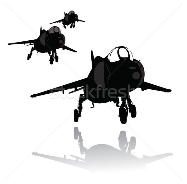 посадка плоскости силуэта вектора истребитель отдельный Сток-фото © vadimmmus