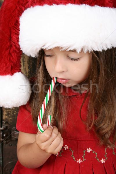 Рождества девушки красивой брюнетка еды конфеты Сток-фото © vanessavr