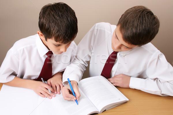 Schooljongen drukke huiswerk uniform Stockfoto © vanessavr