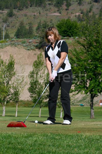 Femminile golfista giocare shot golf Foto d'archivio © vanessavr