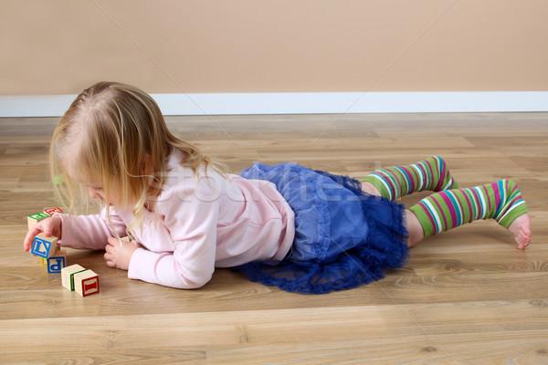 Tömbházak kislány pocak épület gyermek jókedv Stock fotó © vanessavr