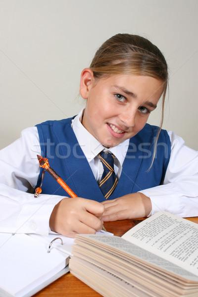 Iskolás lány tini elfoglalt házi feladat visel egyenruha Stock fotó © vanessavr