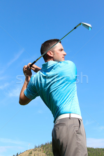 Young golfer hitting a shot with an iron  Stock photo © vanessavr