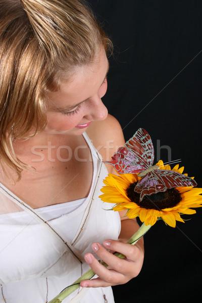 Fiatal modell tini női tart napraforgó Stock fotó © vanessavr