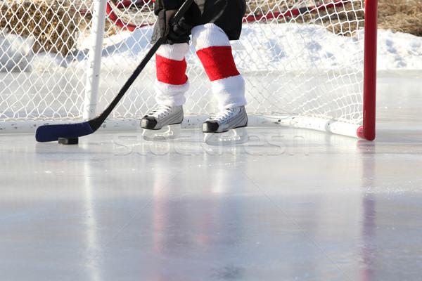 Tavacska jégkorong fiatal gyermek játszik szabadtér Stock fotó © vanessavr