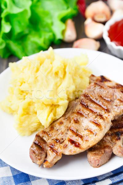 Grilled pork with mashed potato Stock photo © vankad
