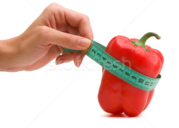 Hand holding measuring tape with paprika Stock photo © vankad