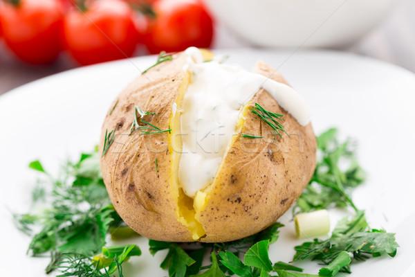 Baked potato with cream sauce Stock photo © vankad