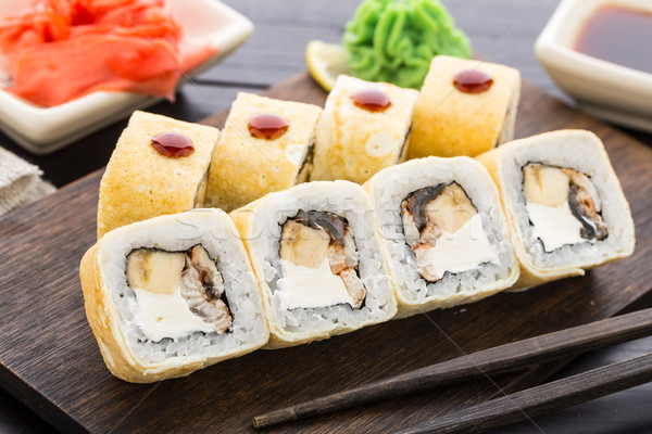 Sushi rolls with smoked eel and banana Stock photo © vankad