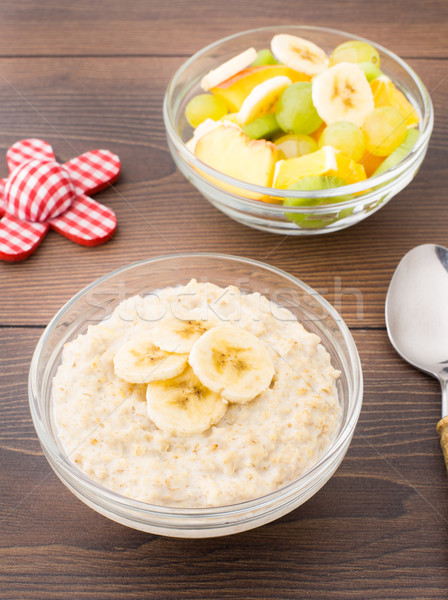 Oat porridge and fruits Stock photo © vankad