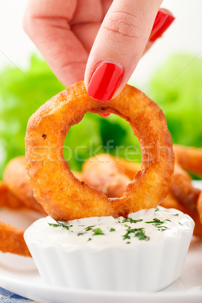 Fingers holding onion ring Stock photo © vankad