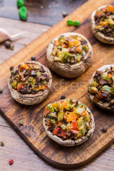 Cogumelos recheado legumes tomates páprica Foto stock © vankad