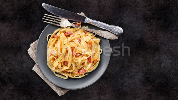 Pasta carbonara on a plate Stock photo © vankad