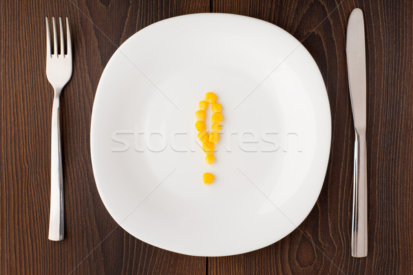Exclamation mark made of corn seeds on a plate Stock photo © vankad