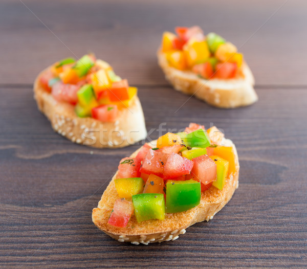 Delicious bruschetta with paprika and herbs Stock photo © vankad